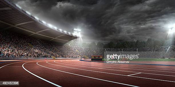 dramatic . stadium with running tracks - athlete stock pictures, royalty-free photos & images