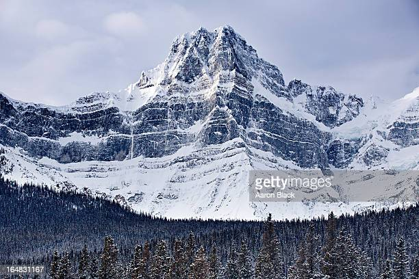 Dramatic steep mountain covered in snow