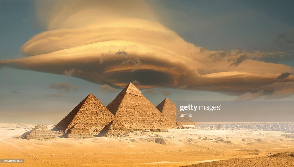Dramatic storm cloud above pyramids, Giza, Egypt : Stock Photo