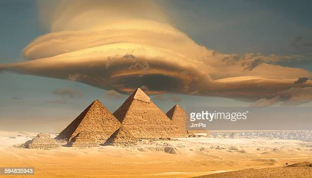 dramatic storm cloud above pyramids, giza, egypt - pyramid stock pictures, royalty-free photos & images