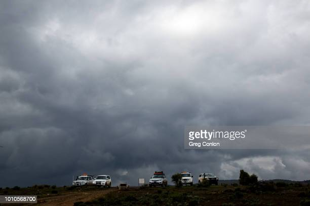 Dramatic storm clouds over 4WD Vehicles