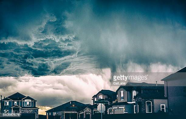 dramatic storm clouds over residential neighborhood. colorado, usa - storm stock pictures, royalty-free photos & images