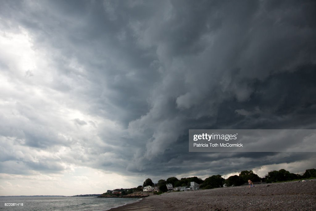 Dramatic Storm Clouds Over Shoreline : Stock Photo