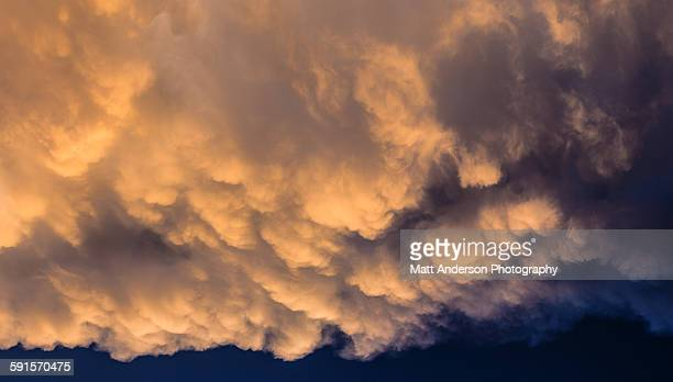 Dramatic storm clouds rolling in at sunset
