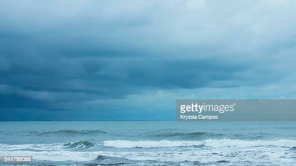 Dramatic stormy sky above tropical beach