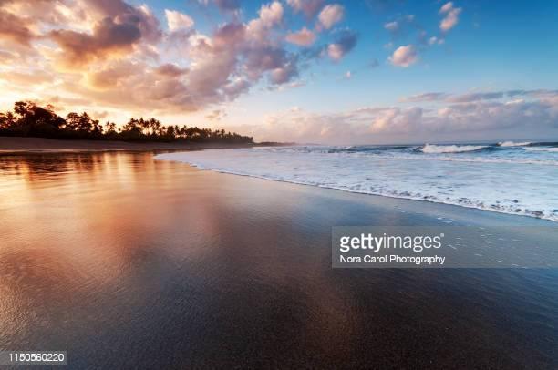 dramatic sunrise at brawa beach in canggu bali - インド洋 ストックフォトと画像