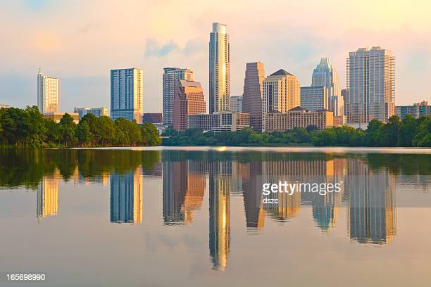 dramatic sunrise austin texas skyline reflected in ladybird lake - austin texas stock pictures, royalty-free photos & images