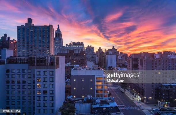 dramatic sunrise skyline - new york - east village stock pictures, royalty-free photos & images