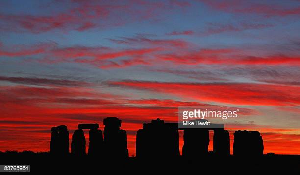 A dramatic sunset acts as a backdrop to Stonehenge on November 20 2008 in Stonehenge England