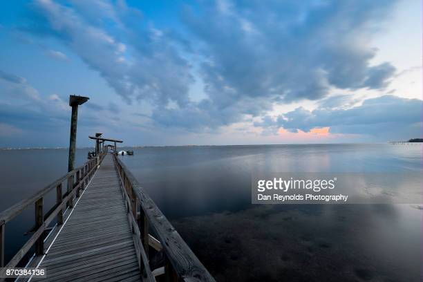 Dramatic Sunset and Pier on water