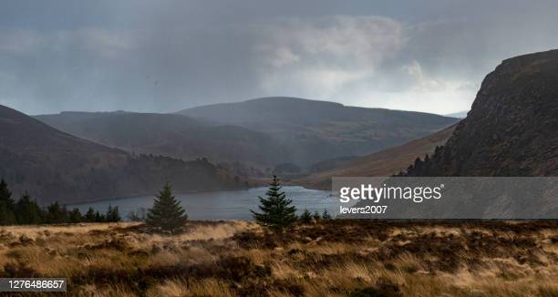 dramatic sunset at lake lough tay or the guinness lake in county wicklow where vikings village, kattegat was located, wicklow mountains, ireland - {{asset.href}} stock pictures, royalty-free photos & images