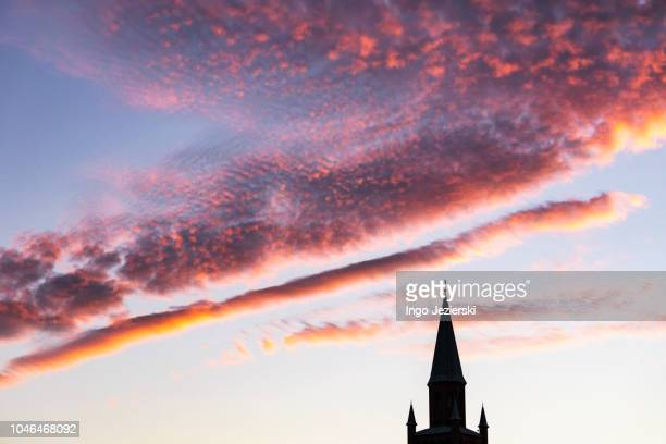 dramatic sunset cloud formation over protestant church ( st. matthäus kirche) - kirche stock pictures, royalty-free photos & images