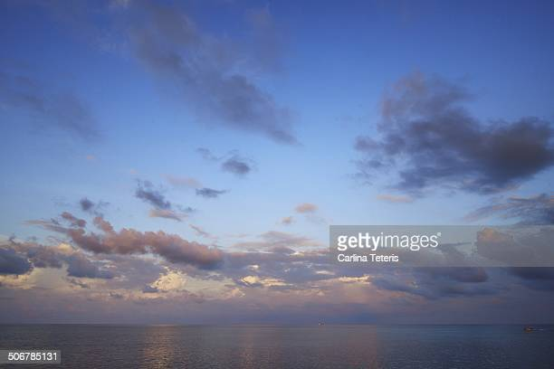 dramatic sunset clouds over the sea - mabul island stock photos and pictures