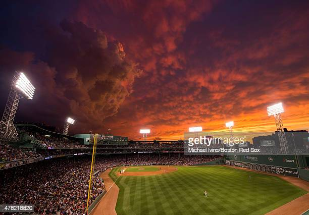 Dramatic sunset illumines the sky during a game between the Boston Red Sox and the Baltimore Orioles at Fenway Park in Boston, Massachusetts on June...