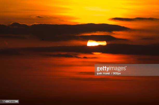 dramatic sunset in burning sky with clouds - ipek morel stock pictures, royalty-free photos & images