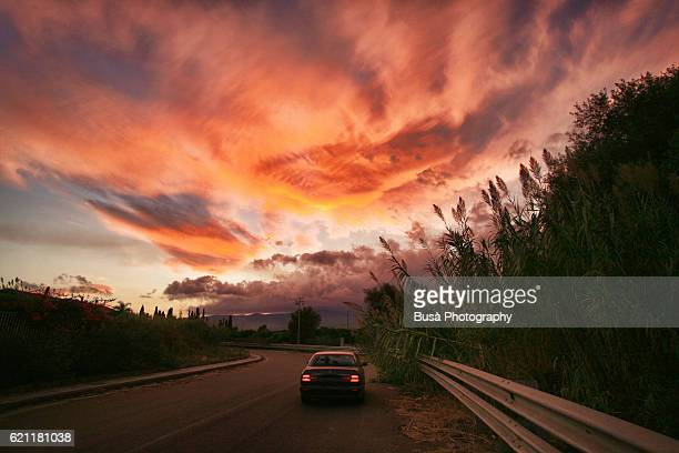 Dramatic sunset on the road to Mount Aetna, Sicily, Italy