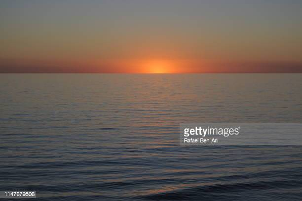 dramatic sunset over gulf st vincent adelaide south australia - rafael ben ari stock pictures, royalty-free photos & images
