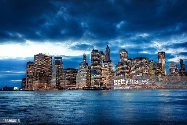 dramatic sunset over manhattan - south street seaport stock photos and pictures