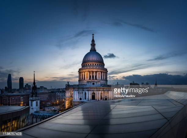 dramatic sunset over st paul's cathedral and london eye - st. paul's cathedral london stock pictures, royalty-free photos & images