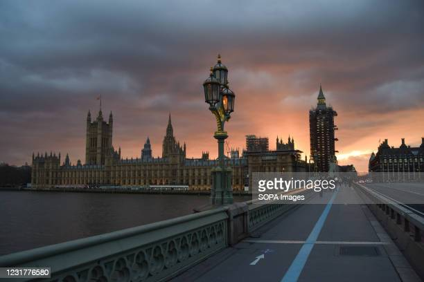 Dramatic sunset over the Houses of Parliament in London.