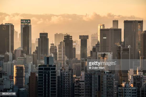Dramatic sunset over the very high densly populated business and residential district of Wan Chai and Happy Valley in Hong Kong island