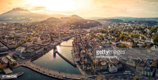 dramatic sunset photo of lucerne city, switzerland - ベルン ストックフォトと画像