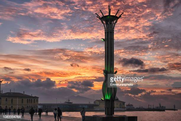 dramatic sunset sky across izmir bay. - emreturanphoto stock pictures, royalty-free photos & images