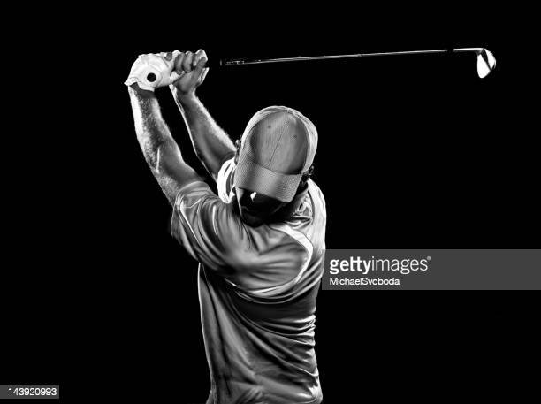 dramatic swing - golf stock pictures, royalty-free photos & images