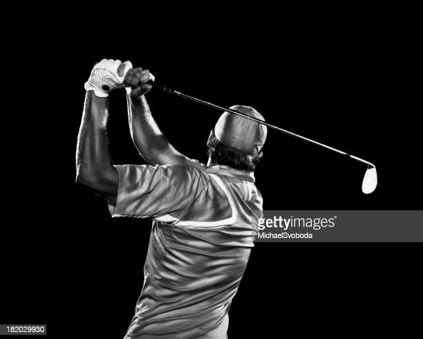 dramatic swing - golf swing stock pictures, royalty-free photos & images