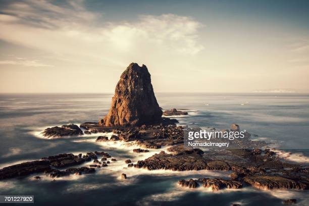 Dramatic Tanjung Papuma with colossal rock in the sea