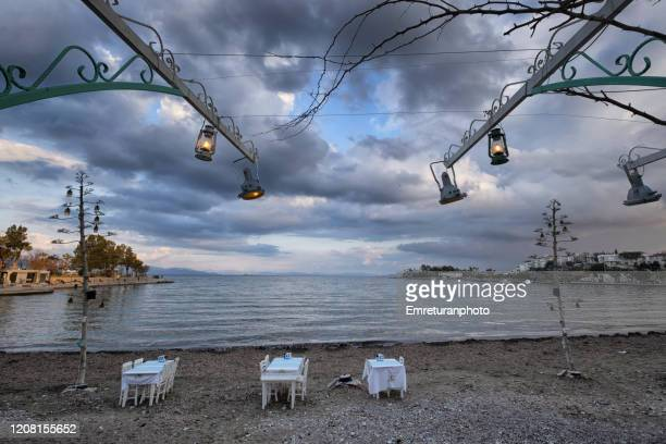 dramatic view of datca beach with lanterns on a cloudy day,aegean turkey. - emreturanphoto stock pictures, royalty-free photos & images