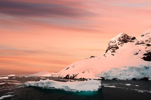dramatic view of iceberg at dusk - gettyimageskorea