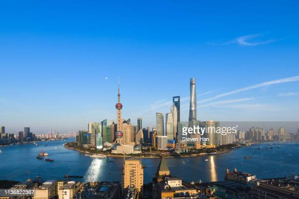 dramatic view of lujiazui in shanghai at dusk - pudong stock pictures, royalty-free photos & images