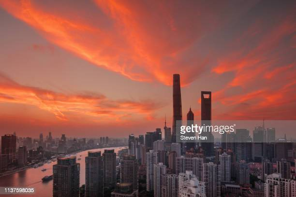 dramatic view of lujiazui in shanghai at dusk - lujiazui stock pictures, royalty-free photos & images