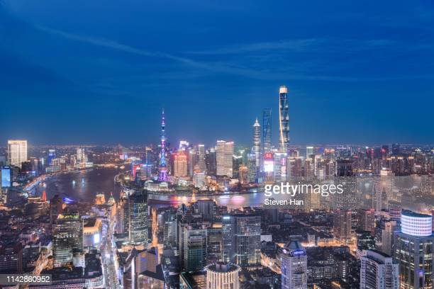 dramatic view of lujiazui in shanghai at night - pudong stock pictures, royalty-free photos & images