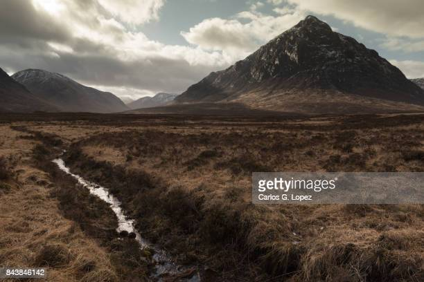 Dramatic view of the hills in the Glen Coe valley with a river