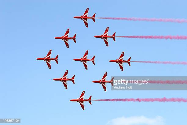 A dramatic view of the Red Arrows Formation Aerobatic Flying Team performing at the Royal International Air Tattoo at RAF Fairford. Acknowledged as one of the world's premier aerobatic teams, The Red Arrows are the public face of the Royal Air Force. The