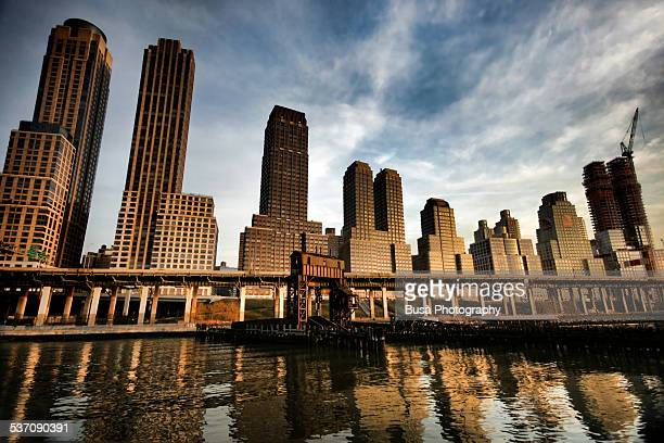 dramatic view of trump place in manhattan - joe dimaggio highway stock photos and pictures
