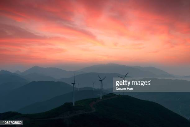 dramatic view of windmills in china - sustainable energy stock pictures, royalty-free photos & images
