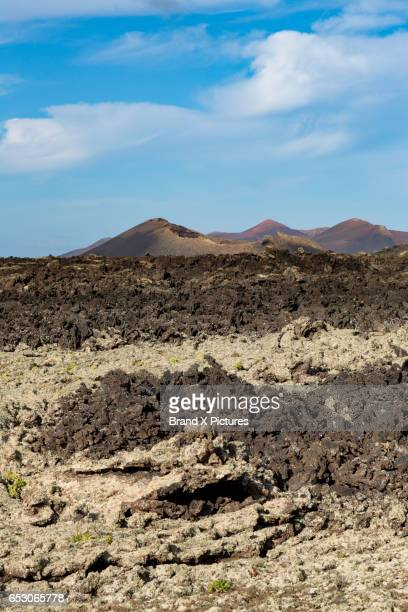 dramatic volcanic landscape near timanfaya national park - atlantic islands stock pictures, royalty-free photos & images