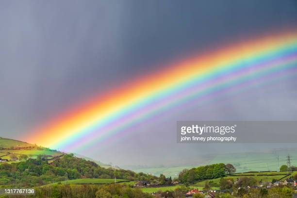 dramatic weather with rainbows and hail over the derbyshire peak district. uk - landscape scenery stock pictures, royalty-free photos & images