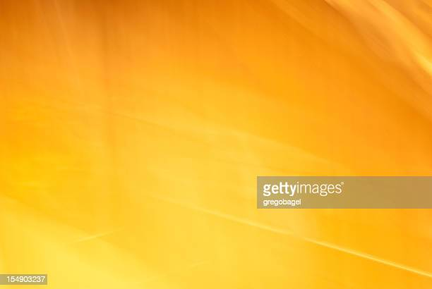 Dramatic yellow-orange light texture or background