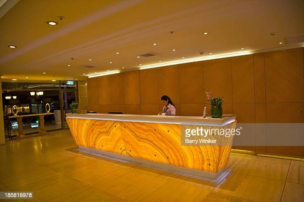 Dramaticy stone back-lit hotel reception desk