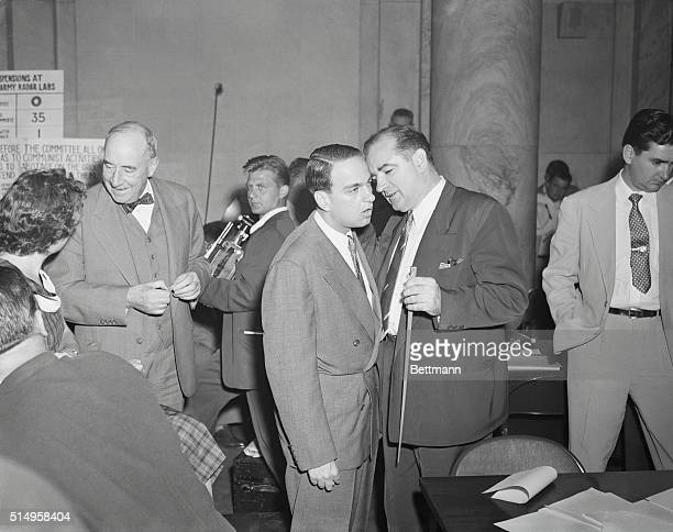 Dramatis Personae in Senate Hearings. Washington: Senator Joseph R. McCarthy holds whispered conference with Roy Cohn after returning to the hearing...