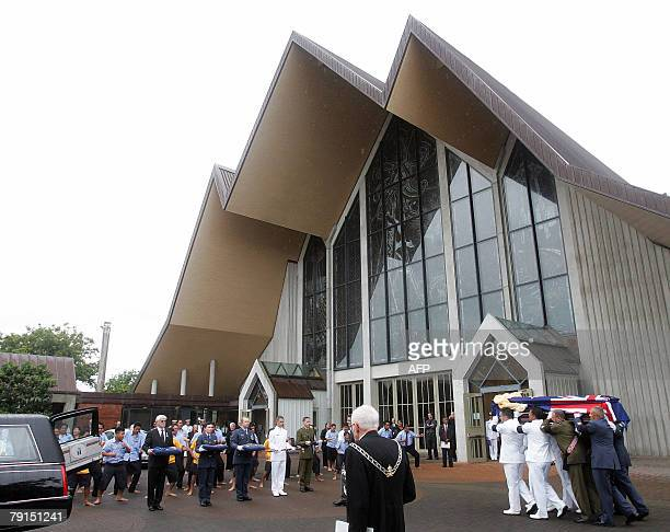 Draped in a New Zealand flag Sir Edmund Hillary's casket leaves the church following his funeral in Auckland 22 January 2008 New Zealand paid tribute...