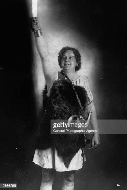 Draped in fur, with a hunting horn slung round his shoulders and holding aloft a flaming torch, Danish-born tenor Lauritz Melchior as Siegfried at...