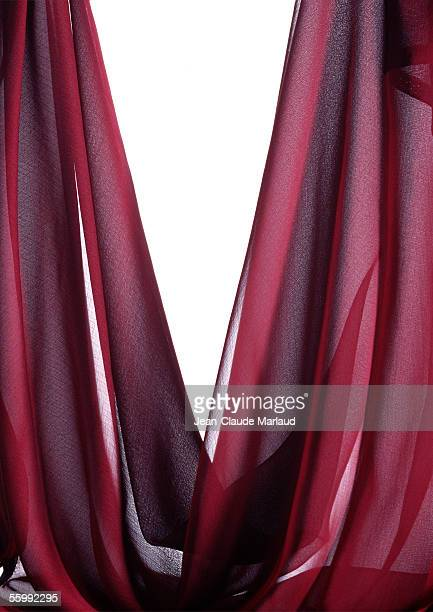 Draped sheer red fabric