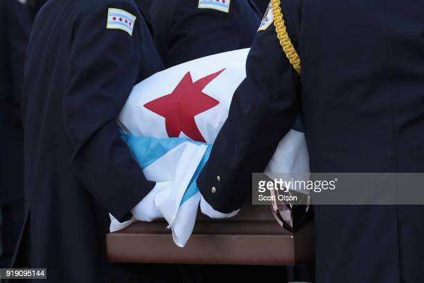 Draped with a city of Chicago plag the remains of Police Commander Paul Bauer arrive at the Nativity of Our Lord church in the Bridgeport...