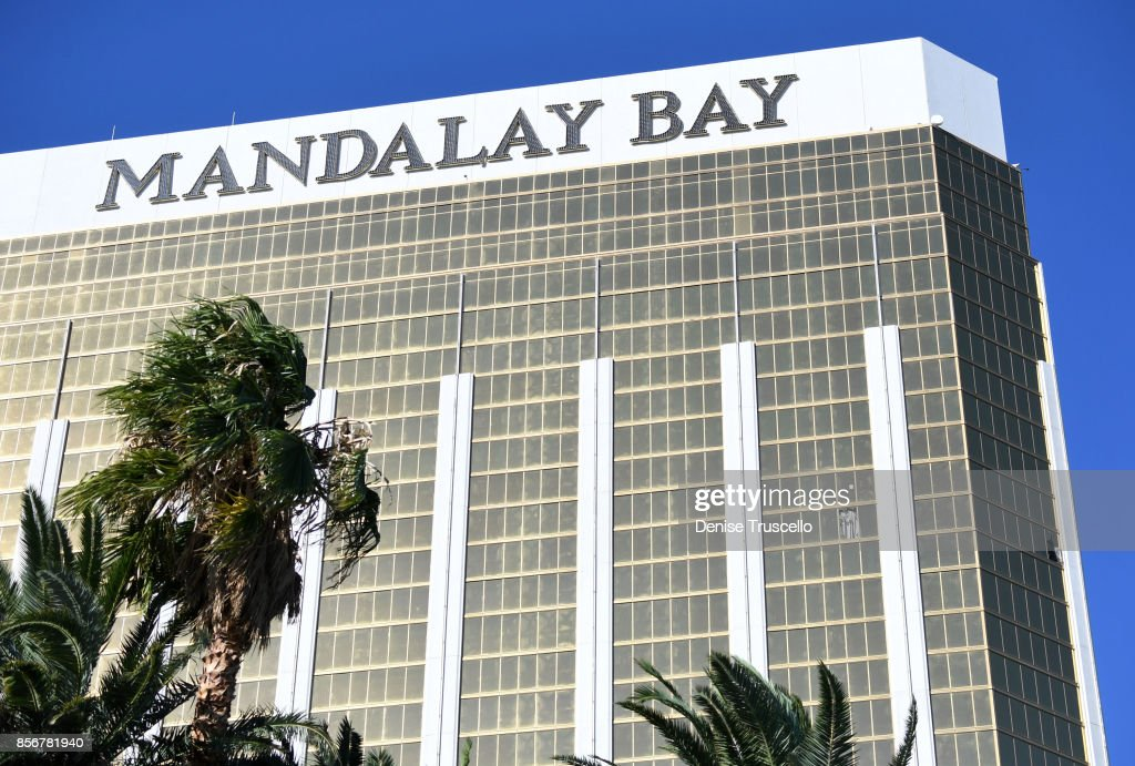 Drapes blow through two broken windows on the 32nd floor of the Mandalay Bay Resort and Casino where a gunman reportedly opened fire through the windows on to the Route 91 Harvest country music fesival, October 2, 2017 in Las Vegas, Nevada. Stephen Paddock, 64, of Mesquite, Nevada, allegedly opened fire from the room on the music festival, leaving at least 58 people dead and over 500 injured. According to reports, Paddock killed himself at the scene.