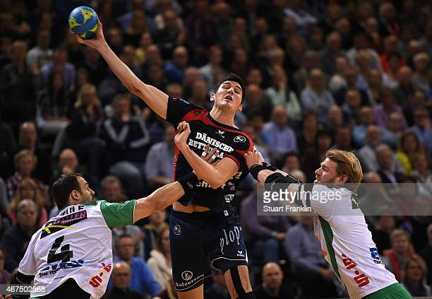 Drasko Nenadic of Flensburg is challenged by Manuel Späth of Goeppingen during the DKB Bundesliga handball match between SG FlensburgHandewitt and FA...